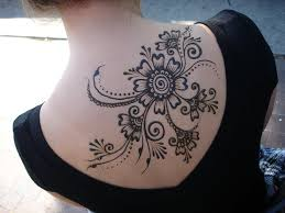 large angel wings and star tattoos on back