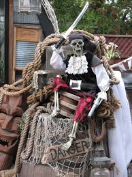 posable halloween skeleton pirate skeleton sitting on top of a barrel of rum in my pirate