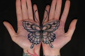 two palm tattoos that combine to become one butterfly ratta