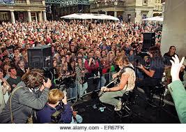 jon bon jovi lead singer of rock group bon jovi busking in