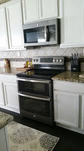 white kitchen cabinets with black slate appliances ge slate appliances with antique white cabinets white
