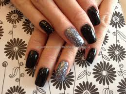 acrylic nails with black gel polish and gun metal grey glitter gel