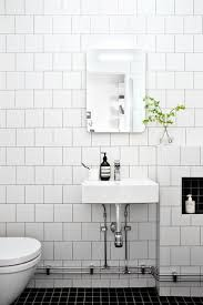 black and white tiled bathroom ideas the 25 best white tile bathrooms ideas on pinterest black subway