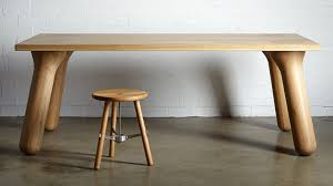 Big Wood Dining Table Daast S Big Foot Table Sits On Wooden Legs