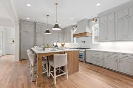 light grey kitchen with oak cabinets gray u shaped kitchen with brown oak island transitional