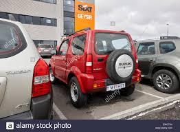 jeep suzuki red suzuki jimny jeep hire car at keflavik airport iceland stock