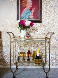 home is where the cart is lighting and loving your bar cart design by emily henderson putting a work of art over the cart is a great idea you can pull colors from it to match with flowers and alcohol or bottles