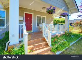 grey house porch red door white stock photo 96711991 shutterstock