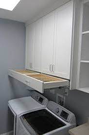 Pinterest Laundry Room Cabinets - omg i love that drying rack drawer laundry room cabinet ideas