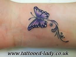 small purple butterfly on wrist one of a cpl together