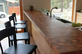 kitchen decoration using dark brown wood butcher block sustainable