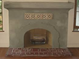 indoor fireplace ideas with simple cement plester fireplace wall
