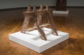 intricate wooden towers made from hundreds of wooden pieces