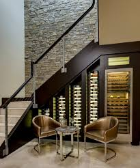 wine bar under stairs wine cellar transitional with stone interior