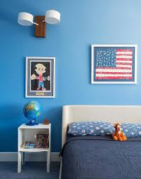 blue boys bedroom with curved gray headboard transitional