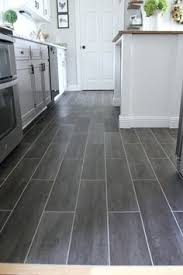 Tile Flooring For Kitchen by Email Post Kitchens Black Cabinet And Wood Planks