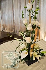 utah wedding event dinner table centerpiece white and green