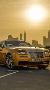 yellow rolls royce wraith rolls royce wraith luxury gold car iphone wallpaper 750x1334