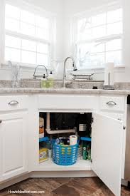 the kitchen sink cabinet organization how to organize your kitchen sink how to nest for less