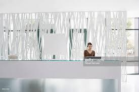 Office Reception Desk Businesswoman Standing At Office Reception Desk Stock Photo