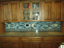 kitchen granite countertops glass tile backsplash dark cabinets