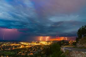 sunset and lightning putting on a technicolor show over rapid city