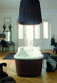 bahtroom big hanging lamp above cool bathtub on wooden floor near