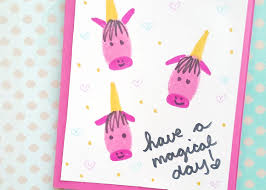 thumbprint unicorn card glued to my crafts