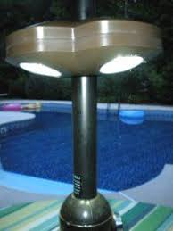 Patio Umbrella Led Lights by This Umbrella Candle Holder Clips Around The Pole And Leaves More