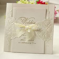 wedding invitations with ribbon 100pcs ivory laser cut floral wedding invitations with ribbon