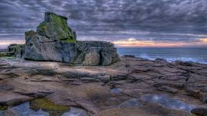 beach pools moss covered rocky seashore clouds sea rocks shore