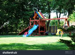 backyard jungle gym made wood slide stock photo 16621255