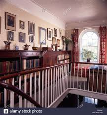 mahogany hand rail and painted banisters on landing of georgian