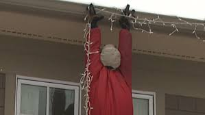 people who hang christmas lights people call 911 for dangling dummy hanging christmas lights wkrc