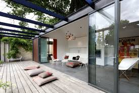 modern south yarra pool house by artillery keribrownhomes architecture modern minimalist pool house design with glass bi fold doors and small living room