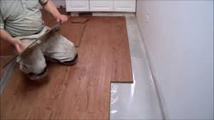 Solid Wood Or Laminate Flooring How To Install Laminate Flooring On Concrete In The Kitchen