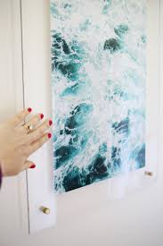 How To Hang Posters Without Damaging Walls by Floating Acrylic Frame Diy U2013 A Beautiful Mess