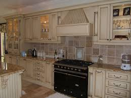 Ivory Colored Kitchen Cabinets Arch Faucet Feat Laminate Wooden Floor Classic Hanging Utensils