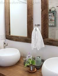 white reclaimed wood framed mirrors featuring the space