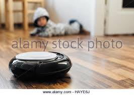 robotic vacuum cleaner on wood parquet floor smart vacuum