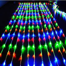 curtain of christmas lights decorate the house with beautiful