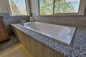 rock pebble surround with garden tub bathroom designs