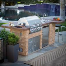 small kitchen grill with island and outdoor backyard pool with