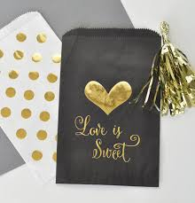black and gold wedding favor goodie bags gold polka dots candy