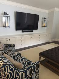 entertainment center beaded inset cabinets with center louvered