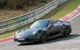 porsche ads 2019 porsche 911 smiles for the camera while testing on the