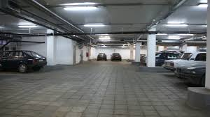 cars standing in underground car park panning stock video footage