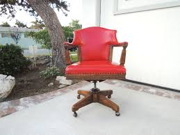 mid century modern wooden swivel desk chair with red leather
