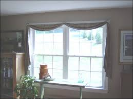 double window treatments a curtain valances can be hung on a double rod that also anchors the