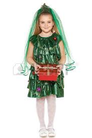 thinking 7 years old in christmas tree costume looking up